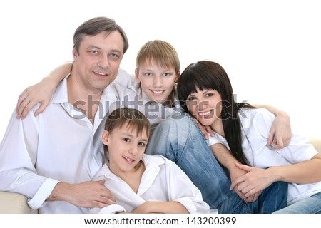 Portrait of Caucasian family of four on a light background