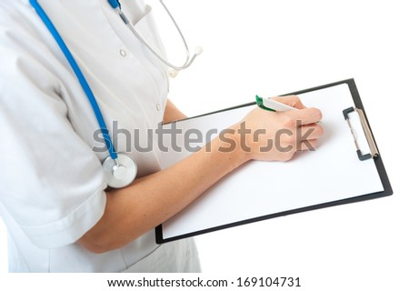 Portrait of Caucasian female doctor with blue stethoscope on neck writing on blank clipboard on white background. Isolated woman doctor in white medical gown