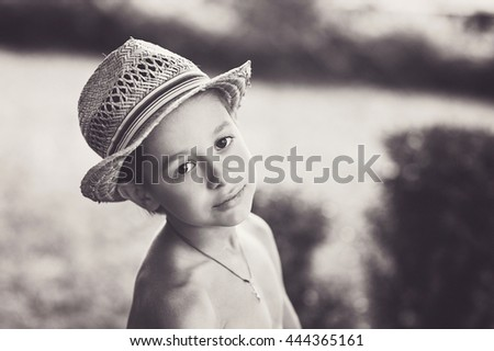 Portrait of caucasian happy baby (boy) in a straw hat. Child is smiling in summer day. Kid is enjoying summer. Image has copyspace for text. Outdoor, close up. - stock photo