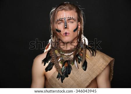 Portrait of Caucasian Man With Native Attire - stock photo