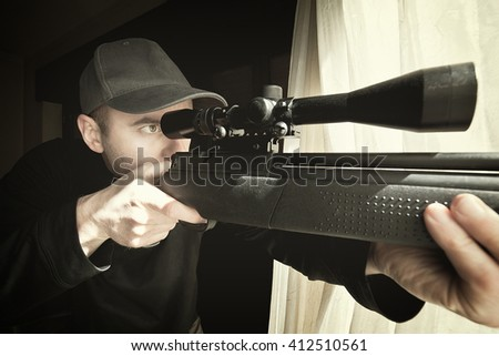 portrait of caucasian sniper with rifle - stock photo