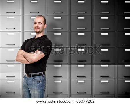 portrait of caucasian worker and file cabinet background