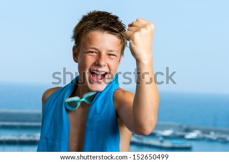 Portrait of champion teen swimmer showing positivity. - stock photo
