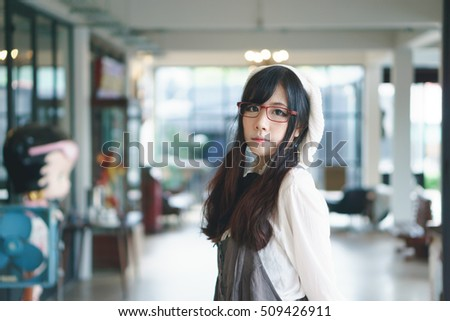 Portrait of charming Asian girl in a coffee shop