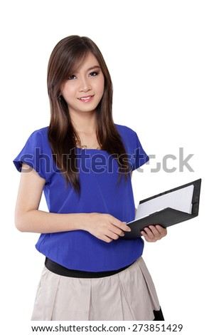 Portrait of charming Asian woman smiling while holding notebook, isolated on white background - stock photo