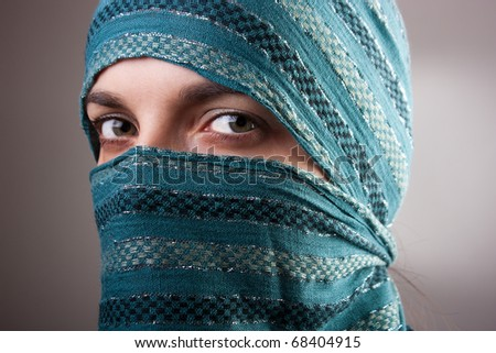 Portrait of charming European woman with shawl. Artistic selective focus. - stock photo