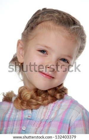 Portrait of charming girl with blond long hair braided in her hair on white background