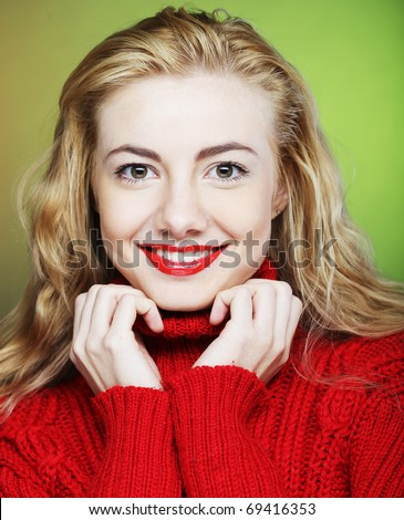 Portrait of charming smiling blonde in red sweater - stock photo