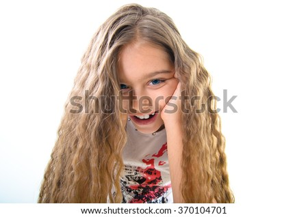 Portrait of charming smiling teenage girl. portrait of a beautiful girl with long hair - stock photo