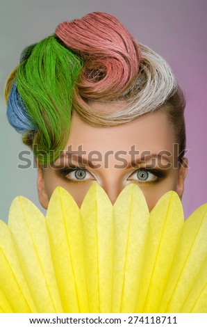 Portrait of charming woman with colorful makeup on colored background - stock photo