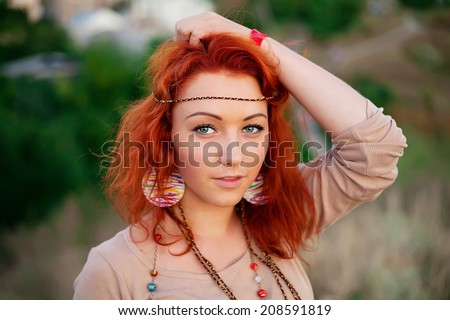 Portrait of charming young red haired girl. Beautiful smile from young woman. Sunset summer sun. Fresh air, happiness, joy, youth, beauty - the concept of advertising on the health of happy people. - stock photo