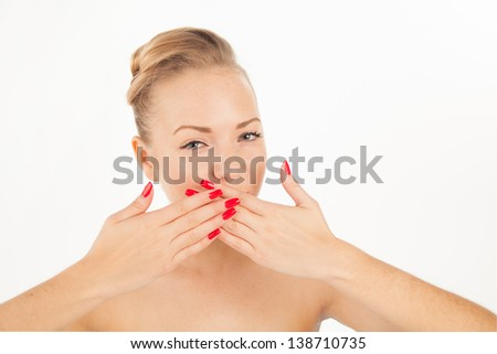 Portrait of charming young woman with red lips and manicure trying to keep silence - stock photo