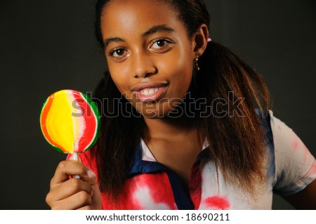 Portrait of cheerful african american child with lollipop - stock photo