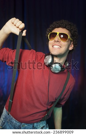 Portrait of cheerful and dancing young man. - stock photo