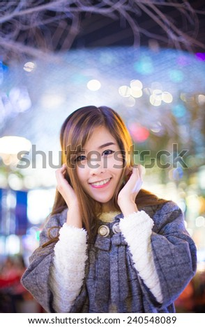 Portrait of cheerful asian girl, standing winter outdoors - stock photo