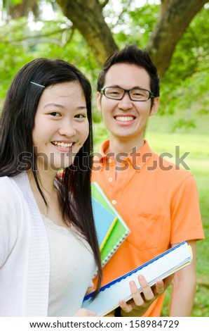 Portrait of cheerful asian students - stock photo