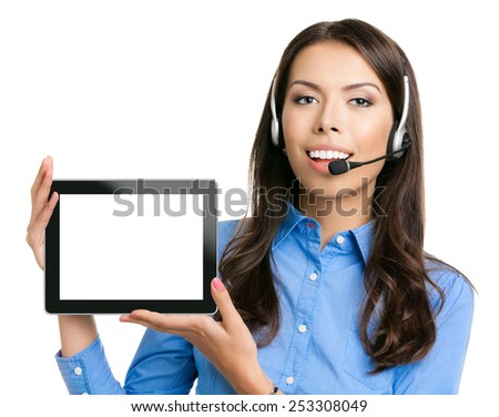Portrait of cheerful beautiful young customer support phone operator showing blank no-name tablet pc monitor, isolated over white background - stock photo
