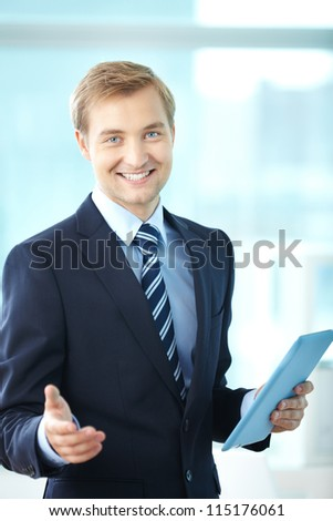 Portrait of cheerful boss in suit looking at camera - stock photo