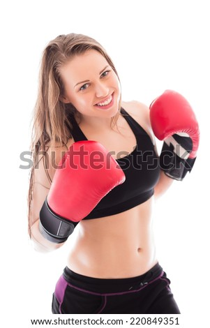 Portrait of cheerful boxer in red gloves. Isolated on white - stock photo