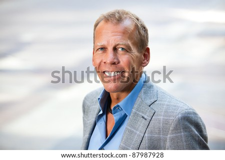 Portrait of cheerful businessman - stock photo