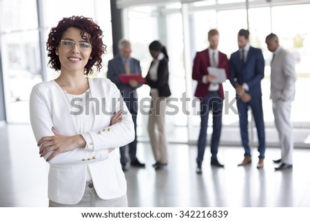 Portrait of cheerful businesswoman at work  - stock photo