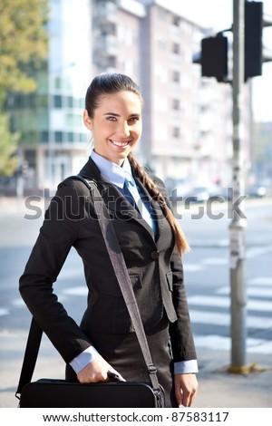 portrait of cheerful businesswoman, outdoor - stock photo