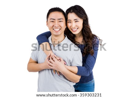 Portrait of cheerful couple against white background - stock photo