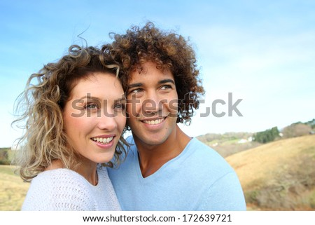 Portrait of cheerful couple in countryside
