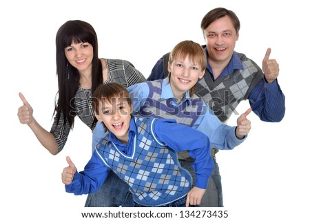Portrait of cheerful family of four in the studio - stock photo