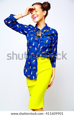 portrait of cheerful fashion hipster girl in casual colorful vivid hipster blue and yellow summer clothes on gray background  - stock photo