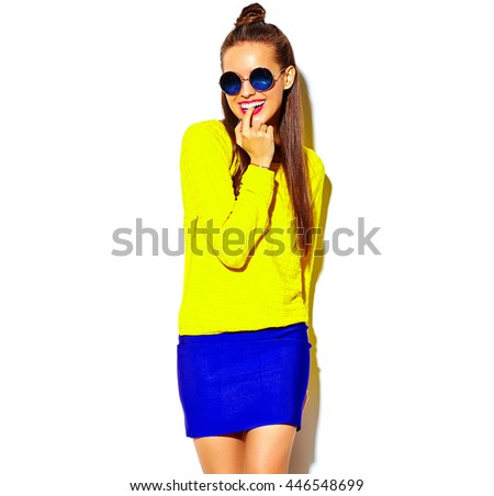 portrait of cheerful fashion smiling hipster girl going crazy in casual colorful yellow summer clothes with red lips isolated on white biting her finger - stock photo