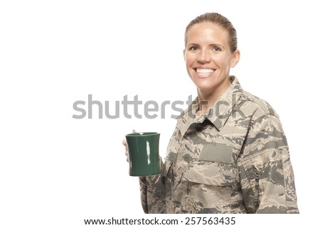 Portrait of cheerful female airman with coffee cup - stock photo