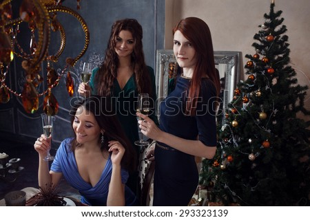 Portrait of cheerful girls at the Cristmas party - stock photo