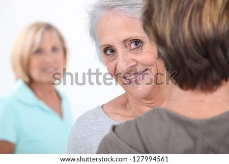 portrait of cheerful grandmother with friends - stock photo
