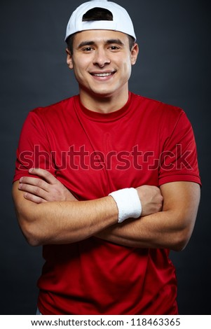 Portrait of cheerful guy in sportswear looking at camera - stock photo