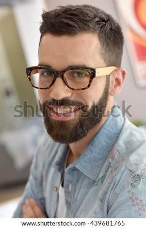 Portrait of cheerful hipster guy