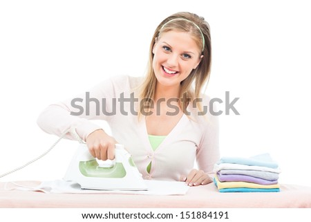 Portrait of cheerful housewife ironing clothes,Housewife ironing - stock photo