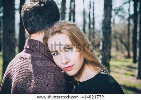 Portrait of cheerful in love couple at spring park - stock photo