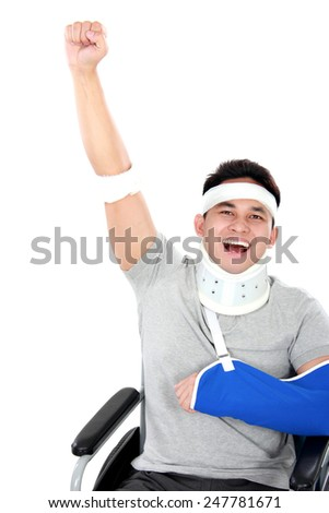 portrait of cheerful injured young man raise his hand - stock photo