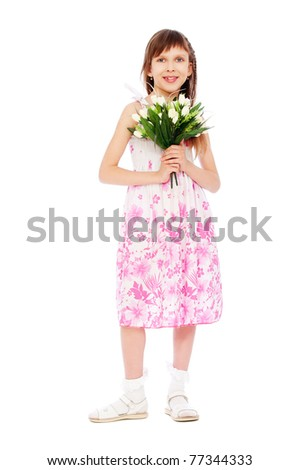 portrait of cheerful little girl with bunch of tulips - stock photo