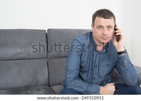 Portrait of cheerful man talking on the phone