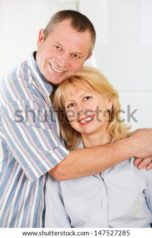 Portrait of cheerful mature man and woman smiling together - stock photo
