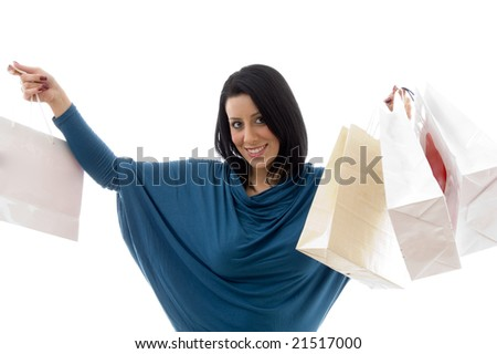 portrait of cheerful model with carry bags against white background - stock photo