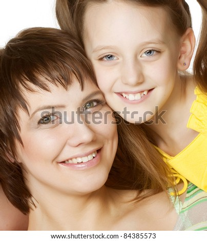 Portrait of cheerful parents with their daughter  on a white background - stock photo
