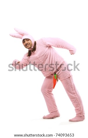 Portrait of cheerful pink rabbit having fun isolated on white background - stock photo