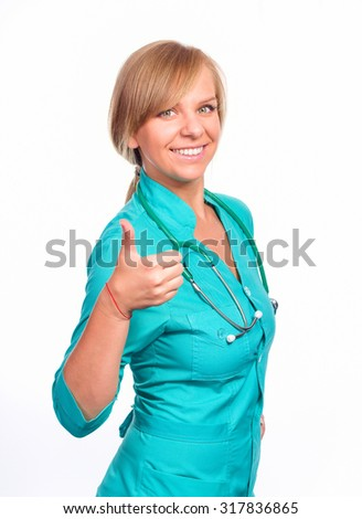 Portrait of cheerful pretty female doctor with thumbs up gesture with stethoscope, isolated over white - stock photo