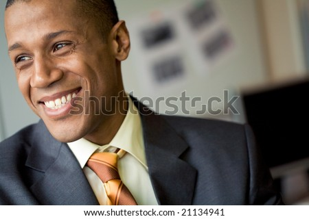 Portrait of cheerful professional looking aside and laughing - stock photo