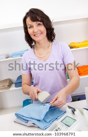 Portrait of cheerful sales person in the retail store - stock photo