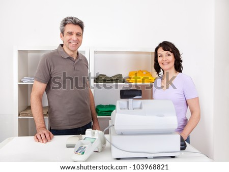 Portrait of cheerful sales persons in the retail store - stock photo