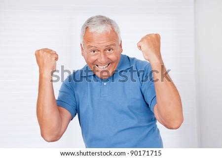 Portrait of cheerful senior man - stock photo